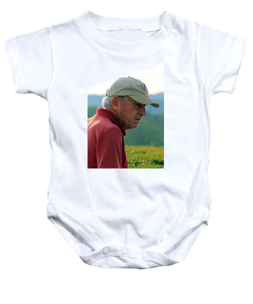 Man Baby Onesie featuring the photograph Man With American Flag On Cap by Cora Wandel