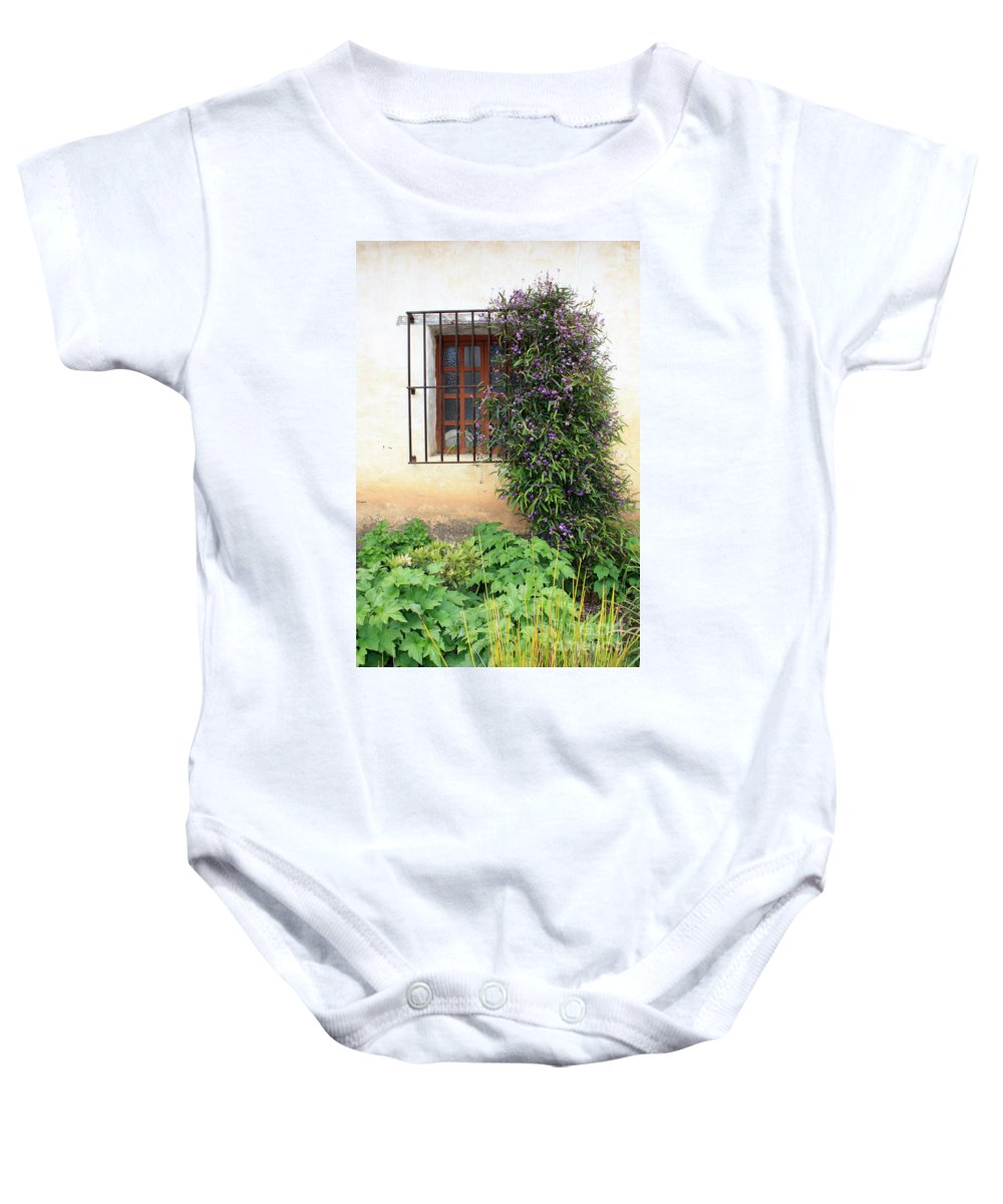 Mission Baby Onesie featuring the photograph Mission Window With Purple Flowers Vertical by Carol Groenen