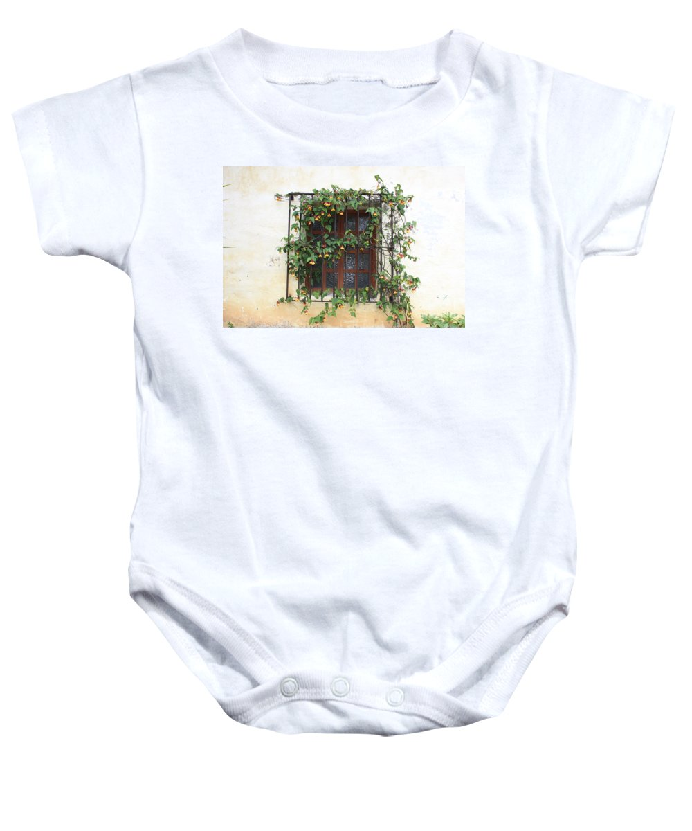 Window Baby Onesie featuring the photograph Mission Window With Yellow Flowers by Carol Groenen