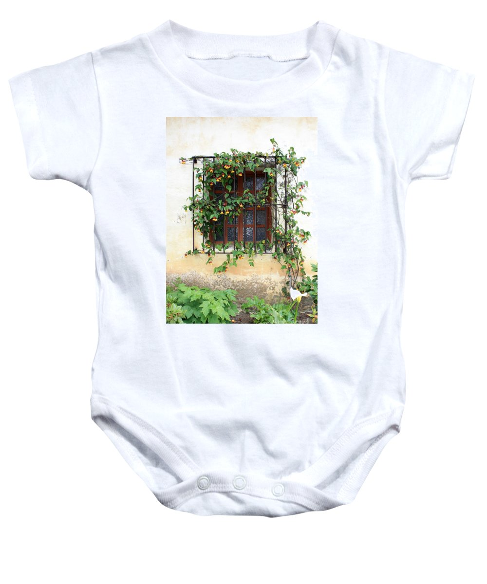Mission Window Baby Onesie featuring the photograph Mission Window With Yellow Flowers Vertical by Carol Groenen