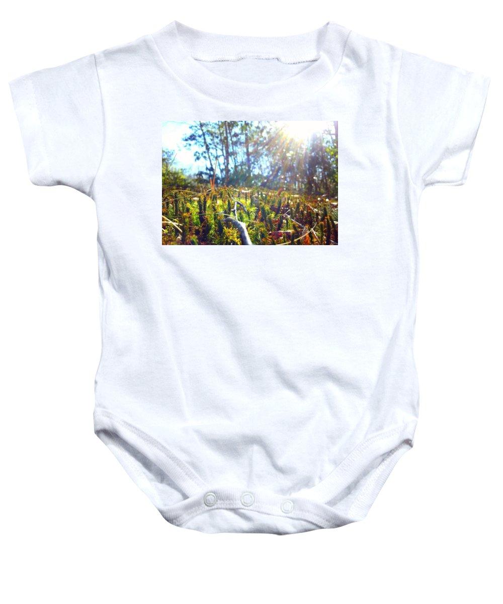 Moss Baby Onesie featuring the photograph Mossy Sunburst by Zen WildKitty