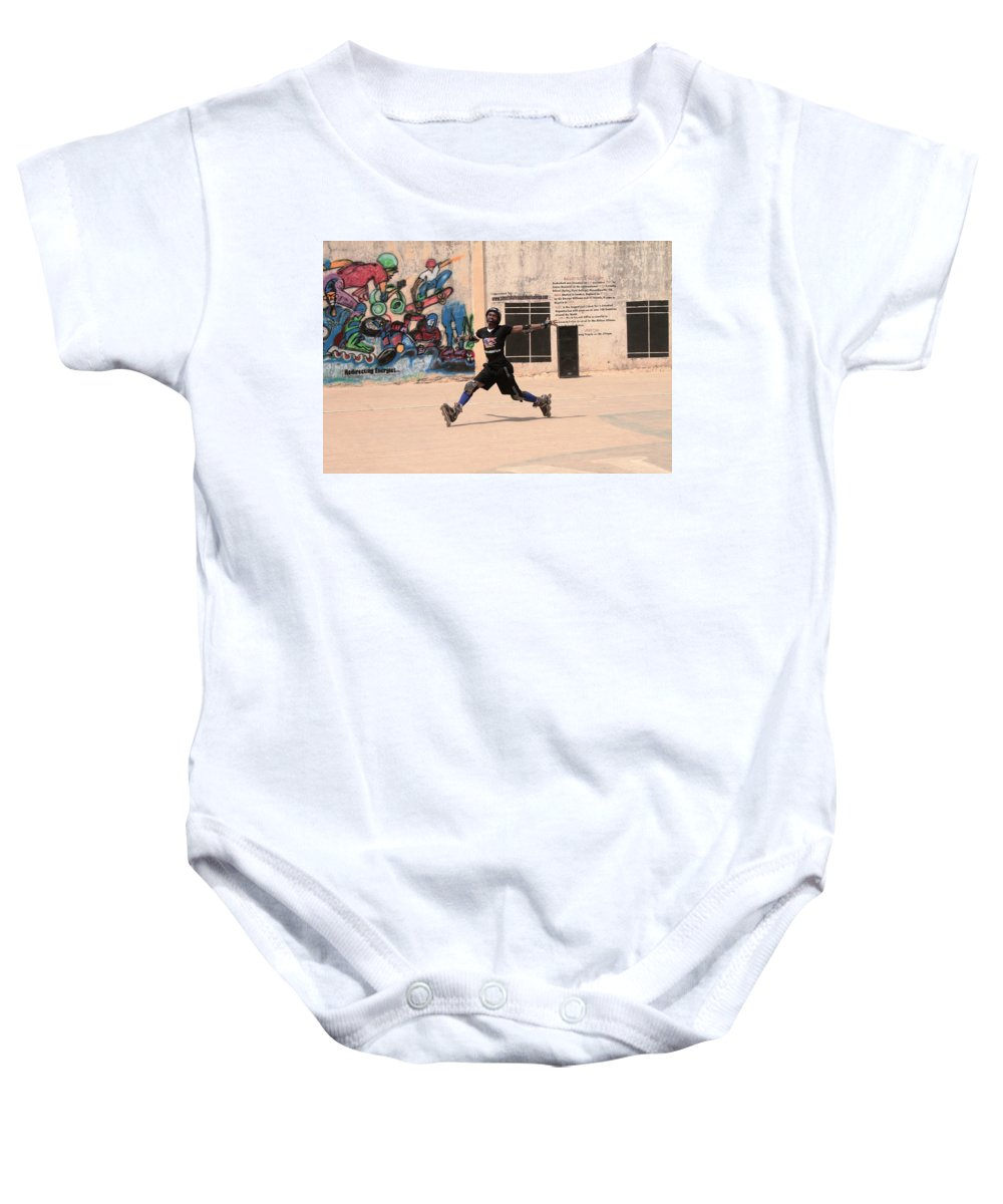 Captured In Motion. Rollerskater Baby Onesie featuring the photograph My Outdoor Photography by Atule Eric-Martins