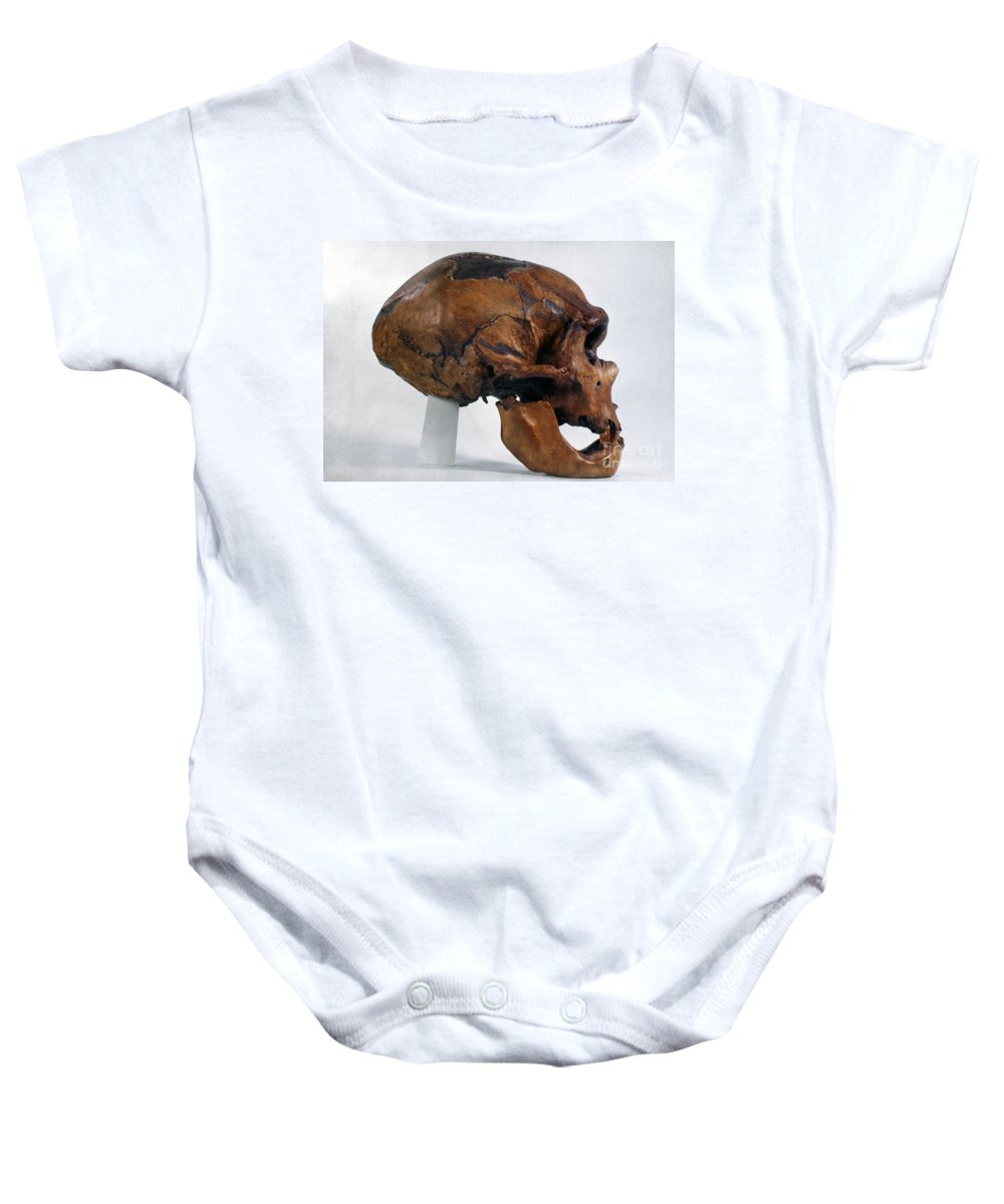 Artifact Baby Onesie featuring the photograph Neanderthal Skull by Granger