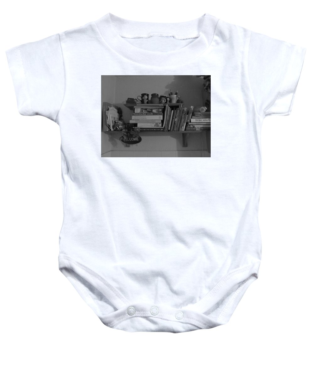 Shelf Baby Onesie featuring the photograph On The Shelf by Debbie Crisp