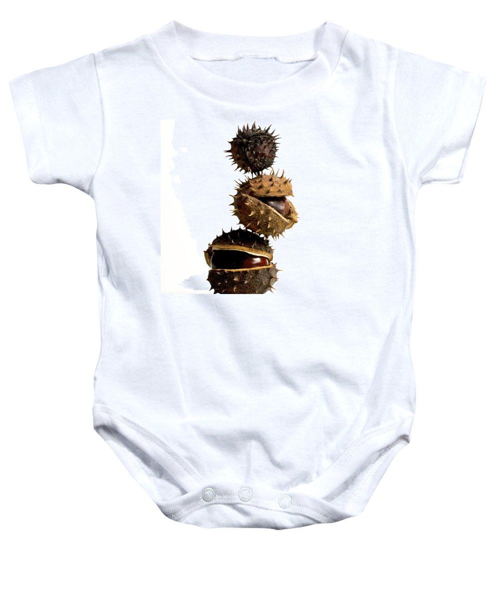 Bogue Baby Onesie featuring the photograph Pile Of Chestnuts by Bernard Jaubert