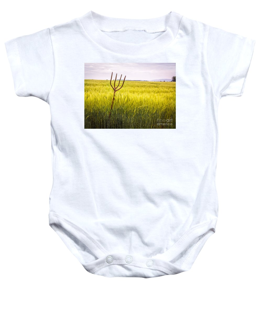 Pitch Baby Onesie featuring the photograph Pitch Fork In Wheat Field by Amanda Elwell