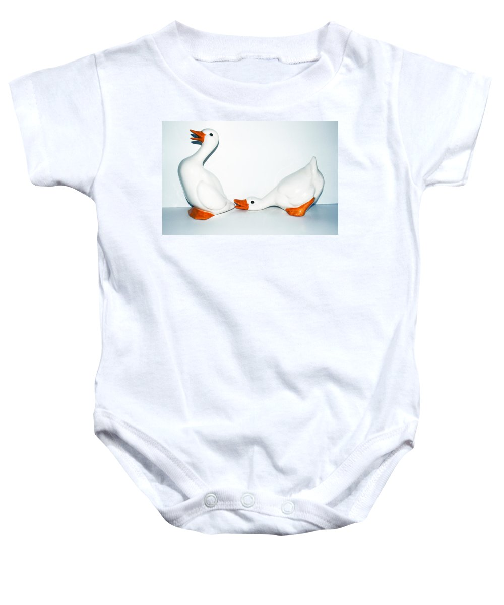 Goose; Geese; Ceramic; Statue; Figure; Figurine; Play; Playful; Bite; Nip; Bird; Fowl; Waterfowl; Ba Baby Onesie featuring the photograph Playful Geese by Allan Hughes