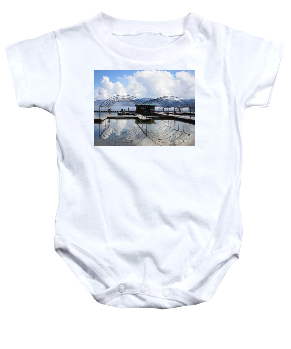 Priest Lake Baby Onesie featuring the photograph Priest Lake Boat Dock Reflection by Carol Groenen