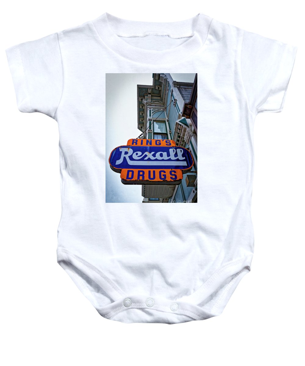 Ring's Rexall Drugs .drugstore Baby Onesie featuring the photograph Ring's Rexall Drugs by Mitch Shindelbower