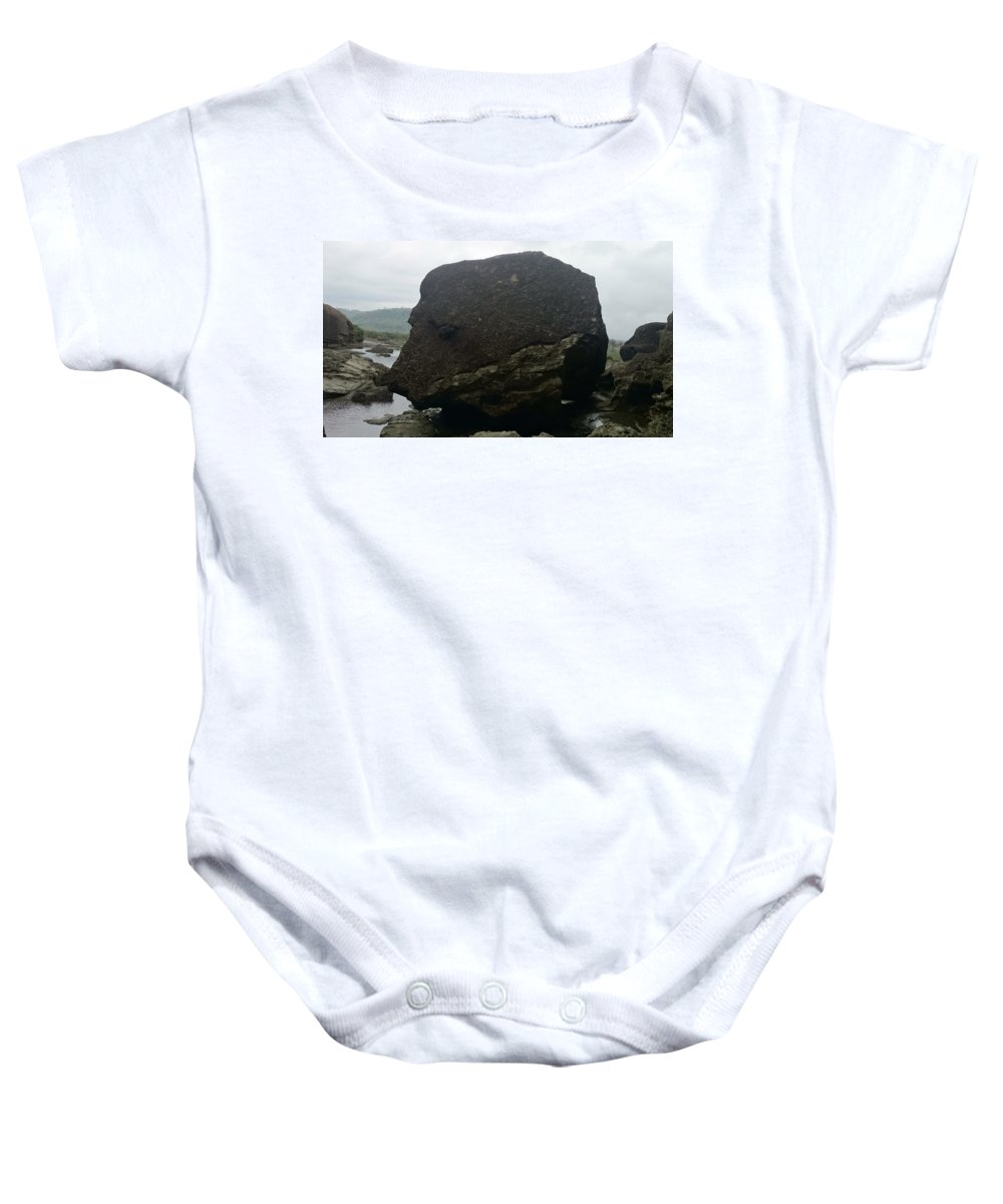 Baby Onesie featuring the photograph Rock Dog's Face by Shahani Egno