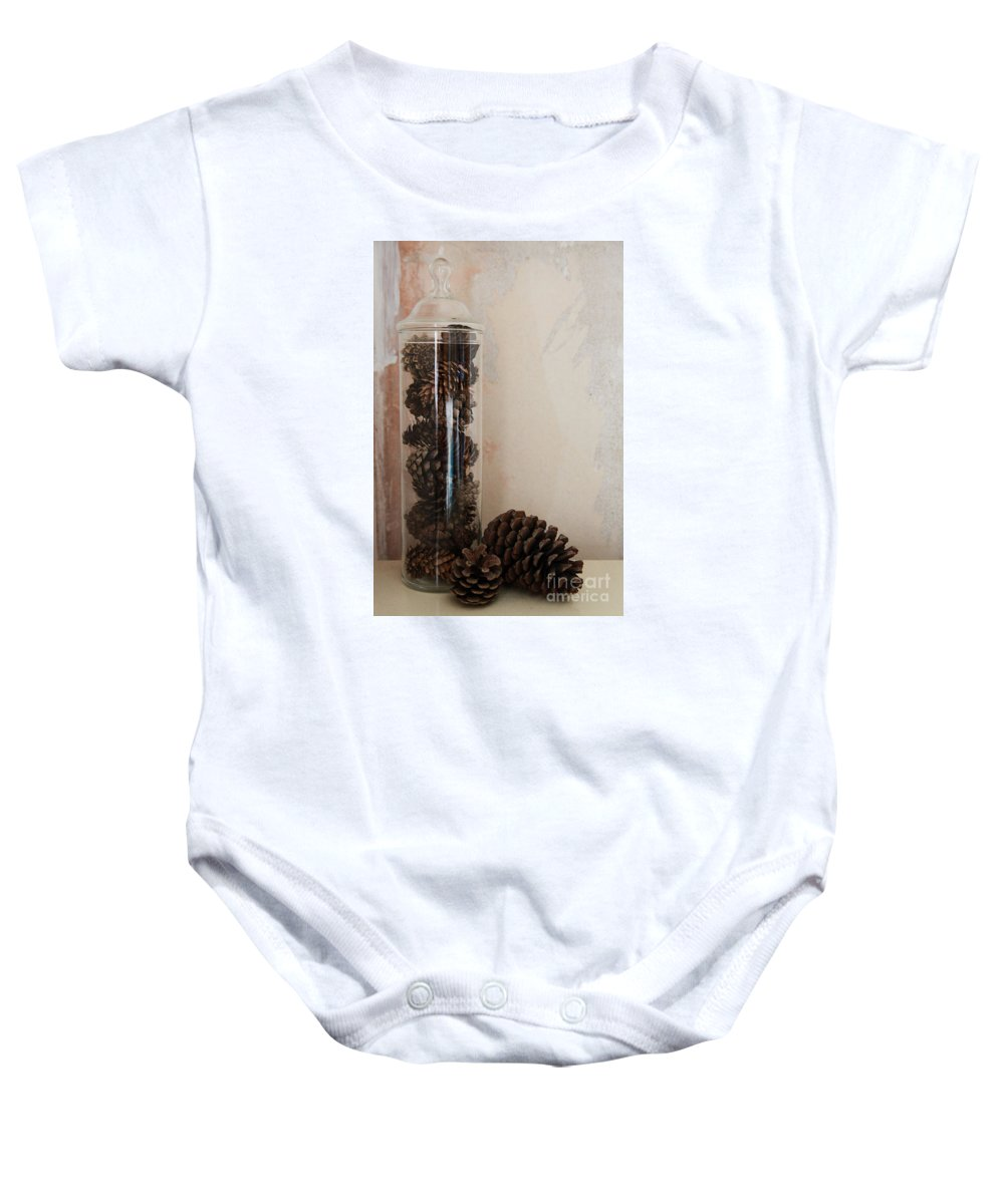 Still Life Baby Onesie featuring the photograph Still Life Of A Glass Jar Of Pine Cones by Jacqui Hall