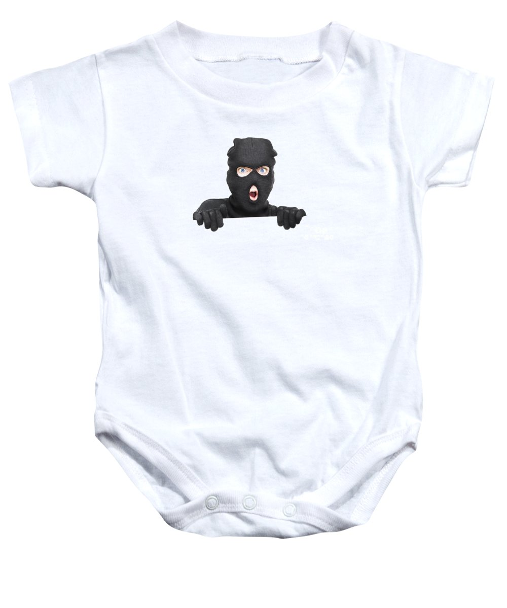 Background Baby Onesie featuring the photograph Surprised Robber Holding Blank Security Sign by Jorgo Photography - Wall Art Gallery