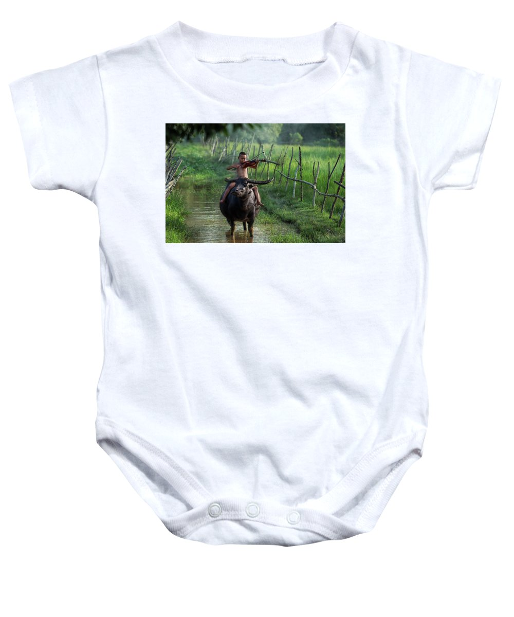 Violin Baby Onesie featuring the photograph The Boy Playing The Red Violin In Thailand, Asia by Somchai Sanvongchaiya