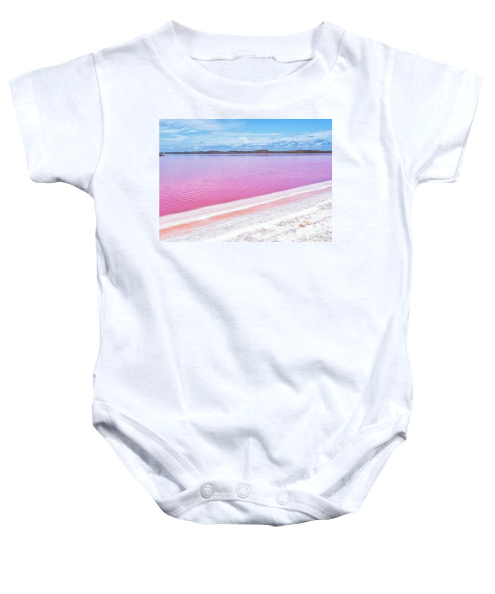 Pink Lake Baby Onesie featuring the photograph The Pink Diagonal by Genevieve Vallee