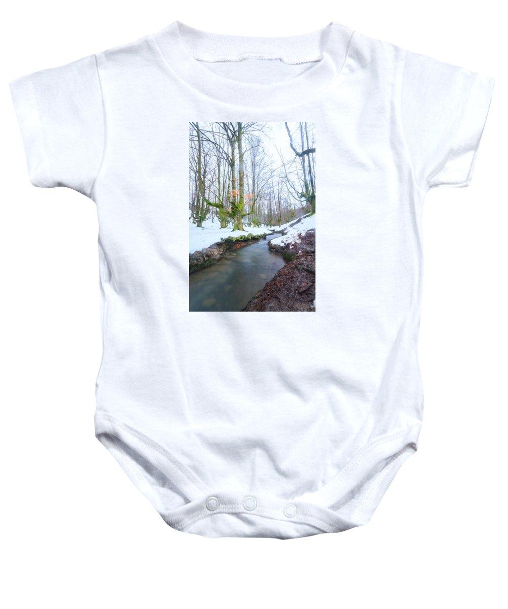 Otzarreta Baby Onesie featuring the photograph The River In The Otzarreta Forest With Snow by Carlos Aragon