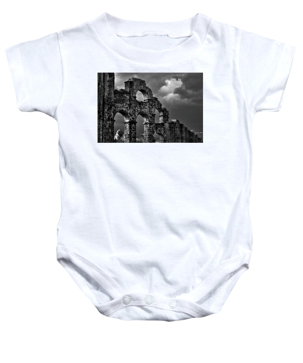 Roman Baby Onesie featuring the photograph The Roman Aqueduct At Aspendos, Turkey.  Black And White by David Lyons