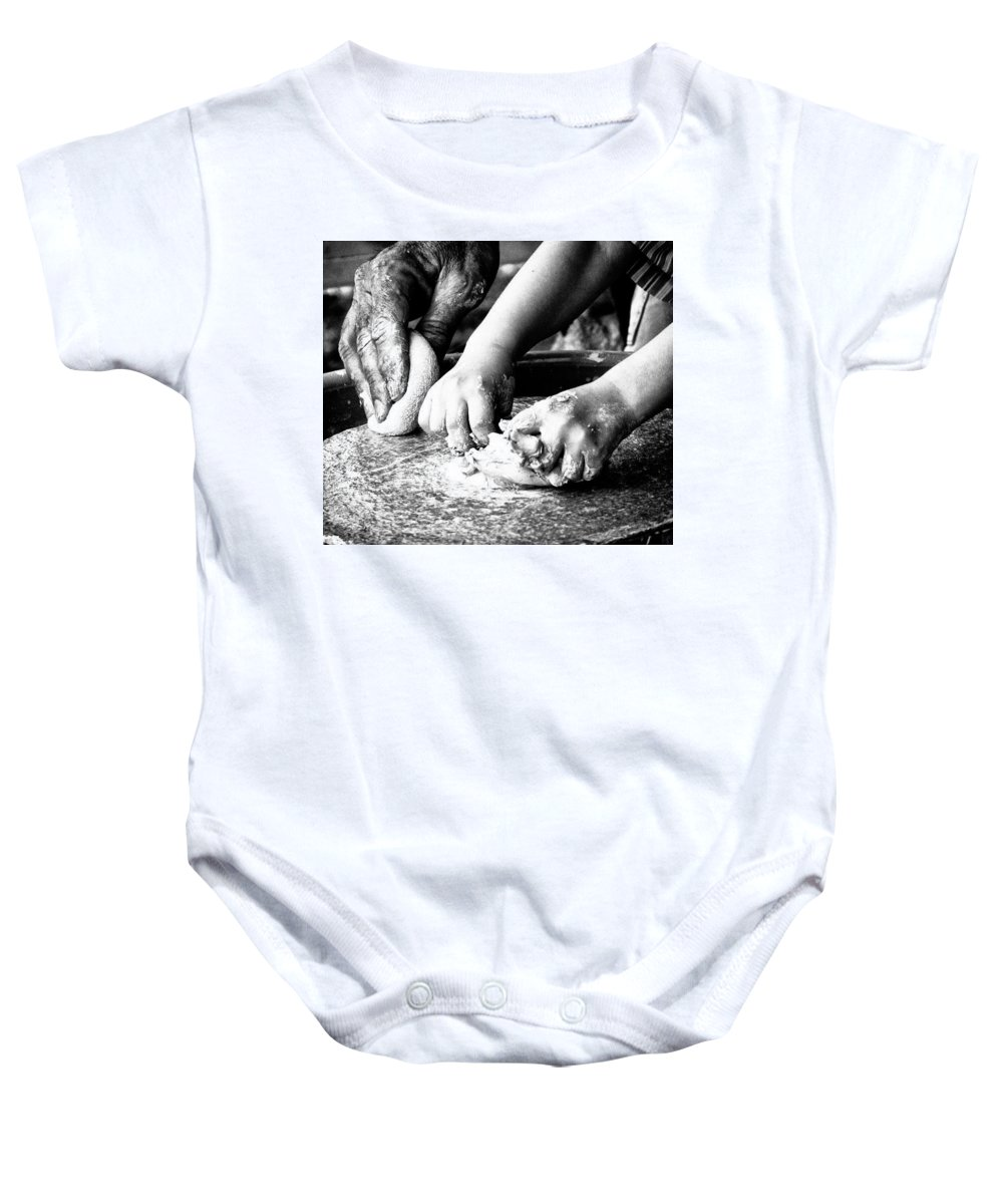 Hands Baby Onesie featuring the photograph The Teacher by John Prickett