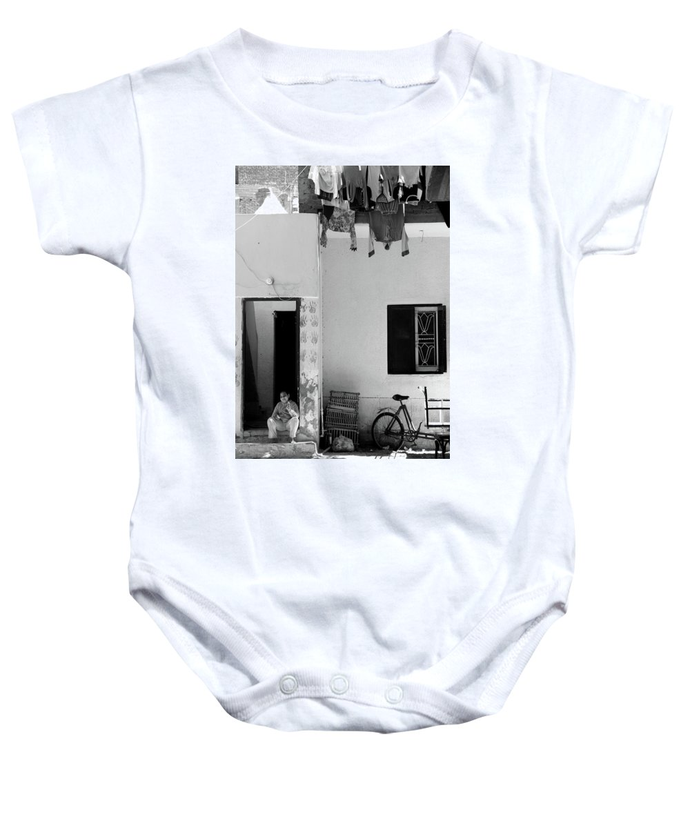 Jezcself Baby Onesie featuring the photograph To Shield by Jez C Self