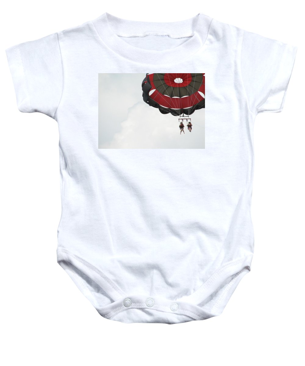 Parasail Baby Onesie featuring the photograph Up Up And Away by Kelly Mezzapelle