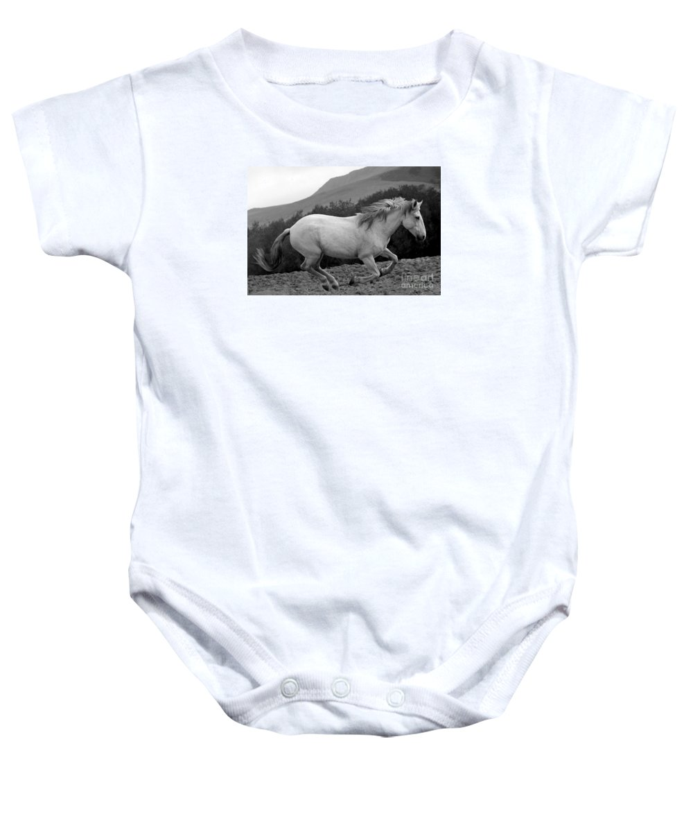 Rtf Ranch Baby Onesie featuring the photograph White Mare Gallops #1 - Close Up Black And White by Heather Kirk
