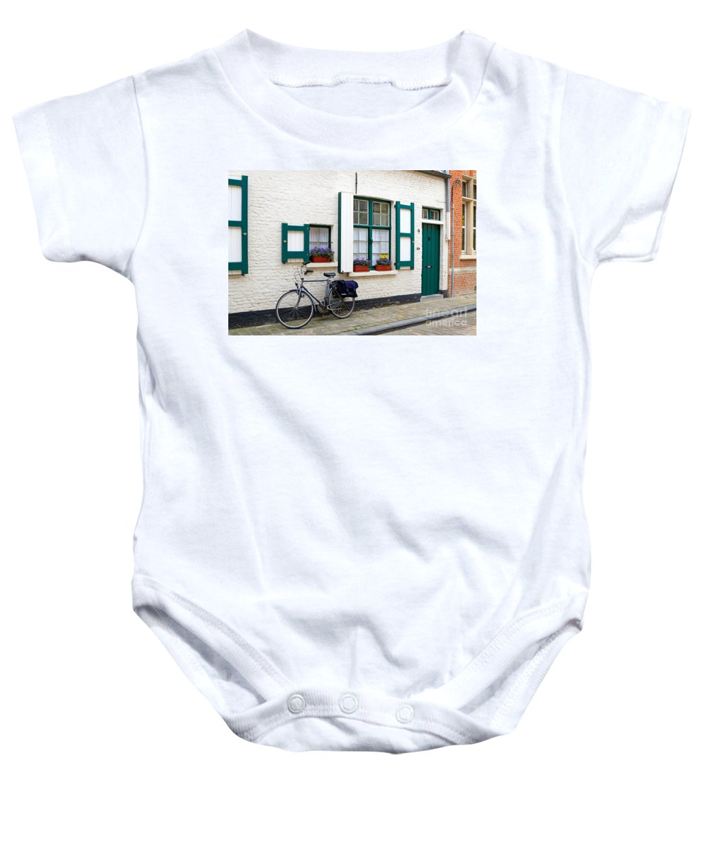 House Baby Onesie featuring the photograph Whitewashed Brick House With Green Trimmed Shutters In Bruges by Louise Heusinkveld
