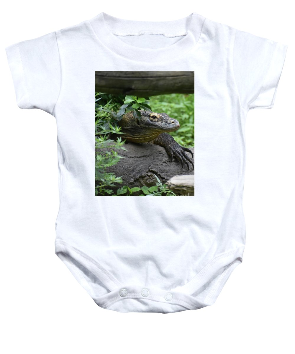 Komodo-dragon Baby Onesie featuring the photograph Wild Komodo Dragon Crawling Through Nature by DejaVu Designs