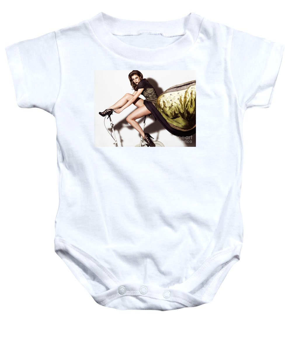 Fashion Baby Onesie featuring the photograph Young Woman In Long Dress On Exercise Bike by Oleksiy Maksymenko