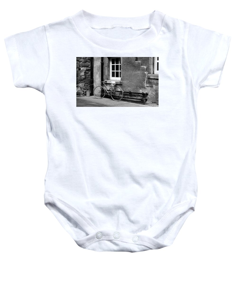 Bicycle Baby Onesie featuring the photograph bicycle in Edinburgh close by Victor Lord Denovan