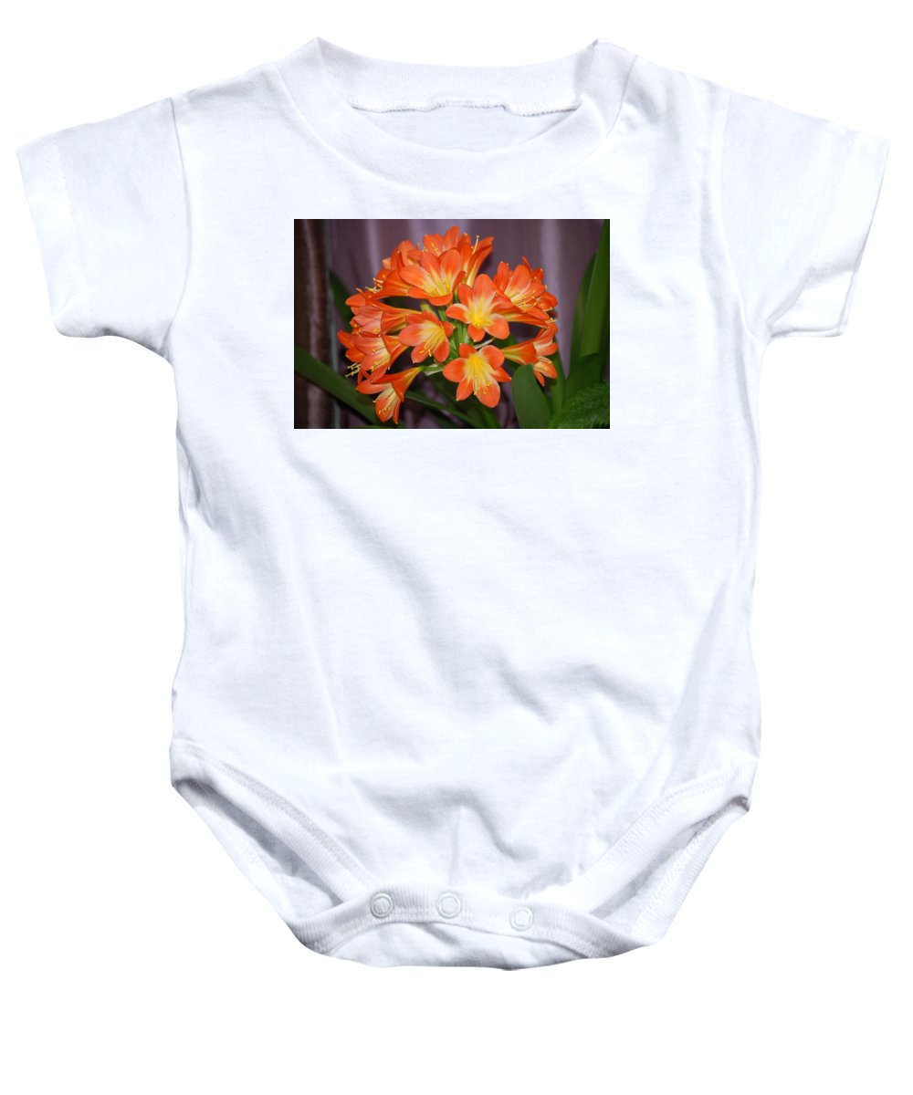 Flowers Baby Onesie featuring the photograph Clivia Blossoms by Nancy Ayanna Wyatt