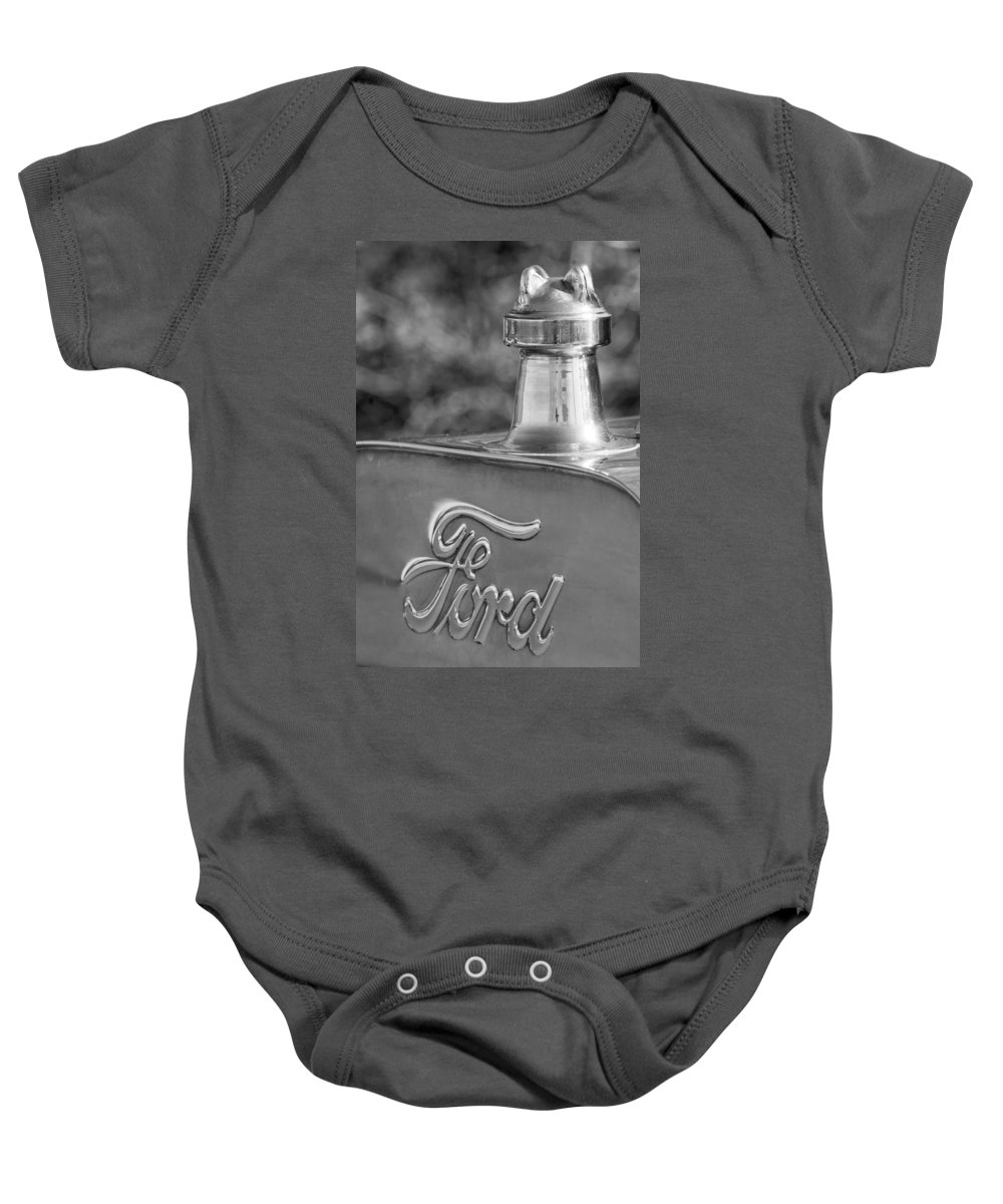 1911 Ford Model T Torpedo 4 Cylinder 25 Hp Hood Ornament Emblem Baby Onesie featuring the photograph 1911 Ford Model T Torpedo 4 Cylinder 25 Hp Hood Ornament Emblem by Jill Reger