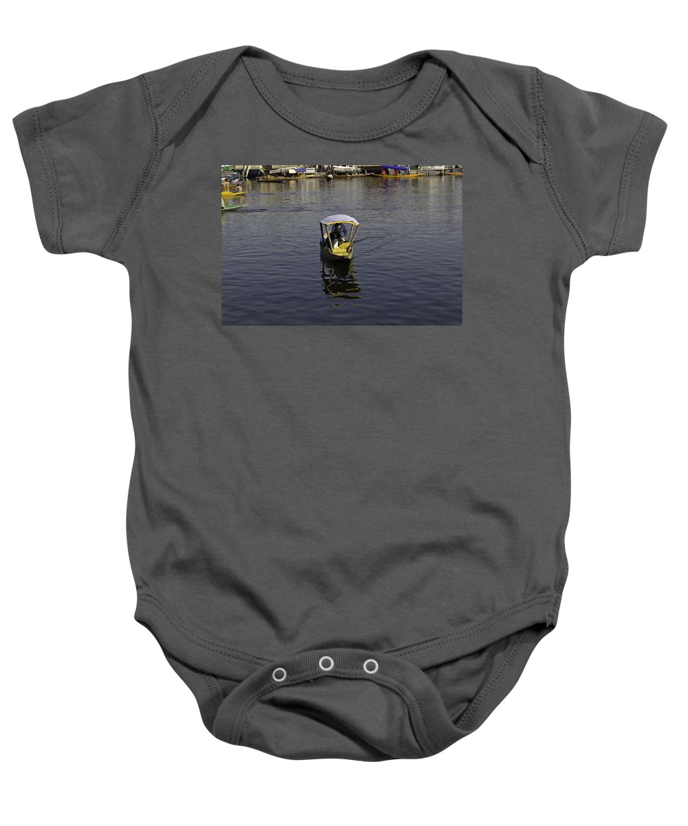 Beautiful Scene Baby Onesie featuring the photograph 2 Kashmiri Men Heading Towards The Camera In A Small Wooden Boat by Ashish Agarwal