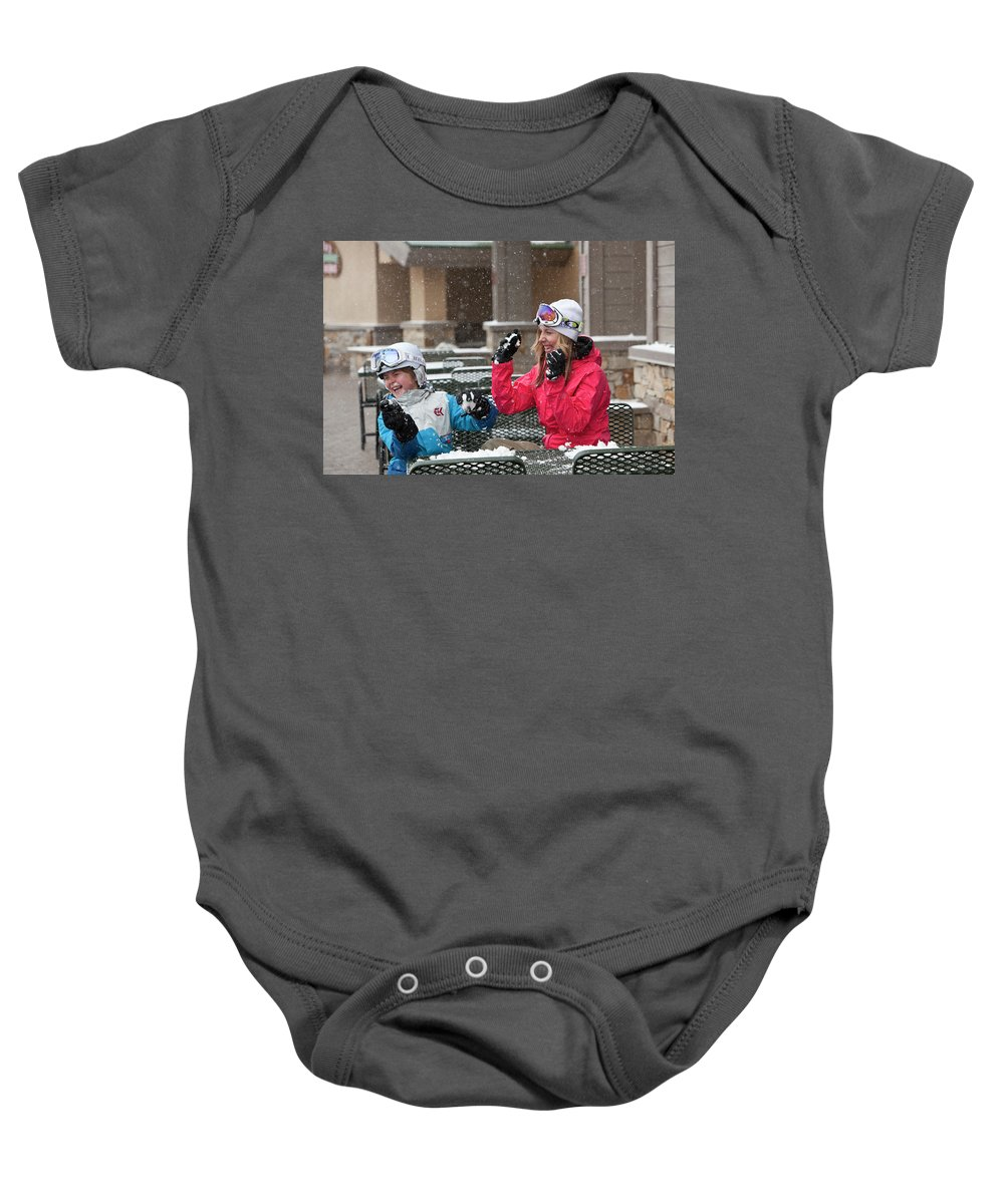 10-11 Years Baby Onesie featuring the photograph A Woman And Child Playfully Throwing by Jose Azel
