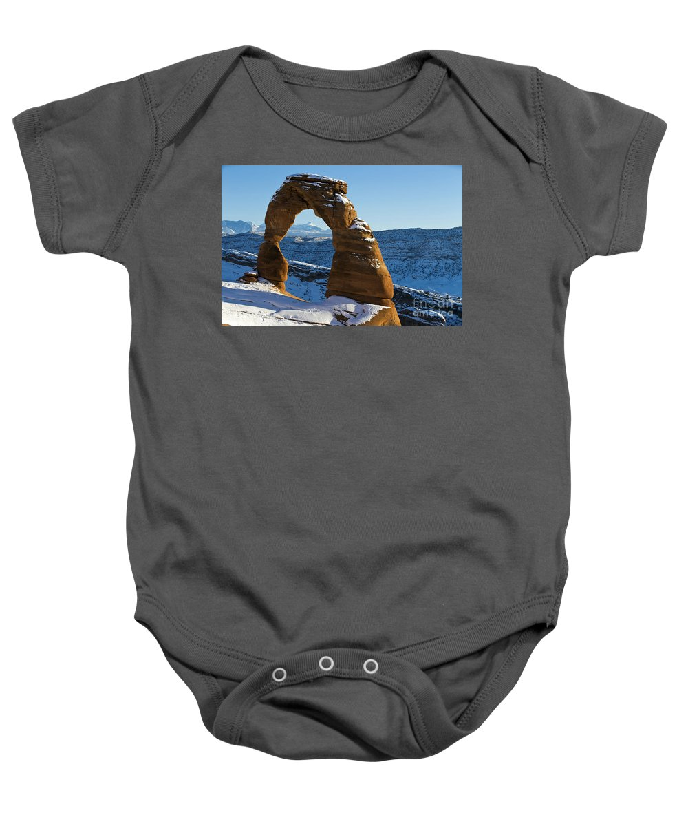 Arches Baby Onesie featuring the photograph Delicate Arch With Snow Arches National Park Utah by Jason O Watson