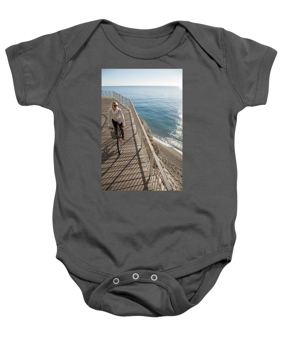 Woman Baby Onesie featuring the photograph Elevated Perspective Of Woman Riding by Philip & Karen Smith / TFA