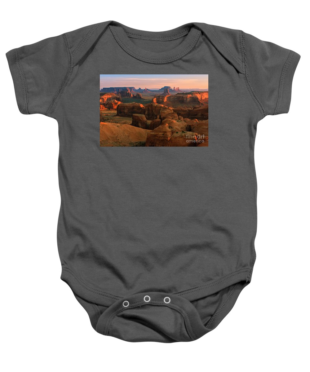 Usa Baby Onesie featuring the photograph Hunts Mesa In Monument Valley by Henk Meijer Photography