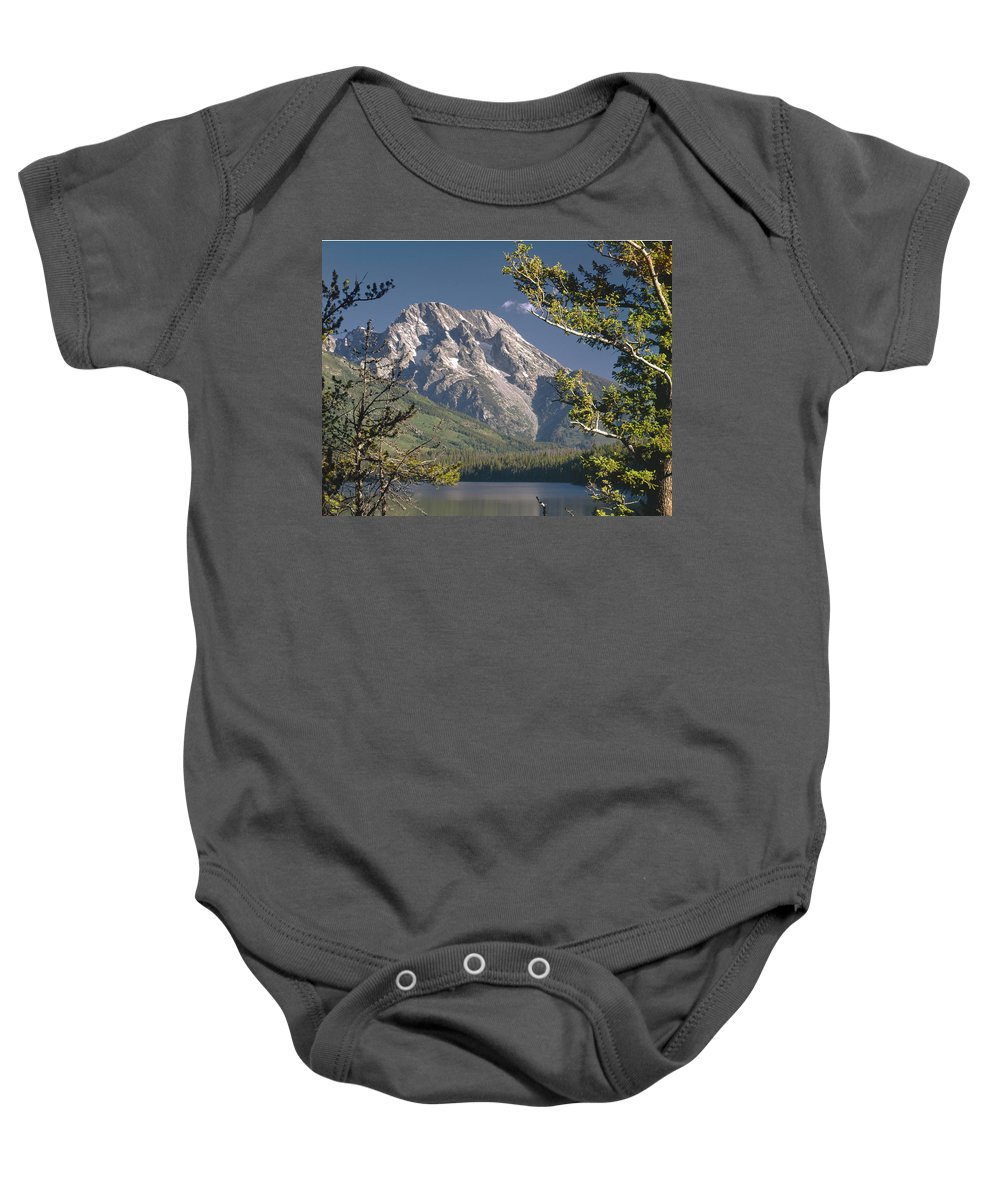 Mt. Moran Baby Onesie featuring the photograph Mt. Moran And Jenny Lake by Ed Cooper Photography