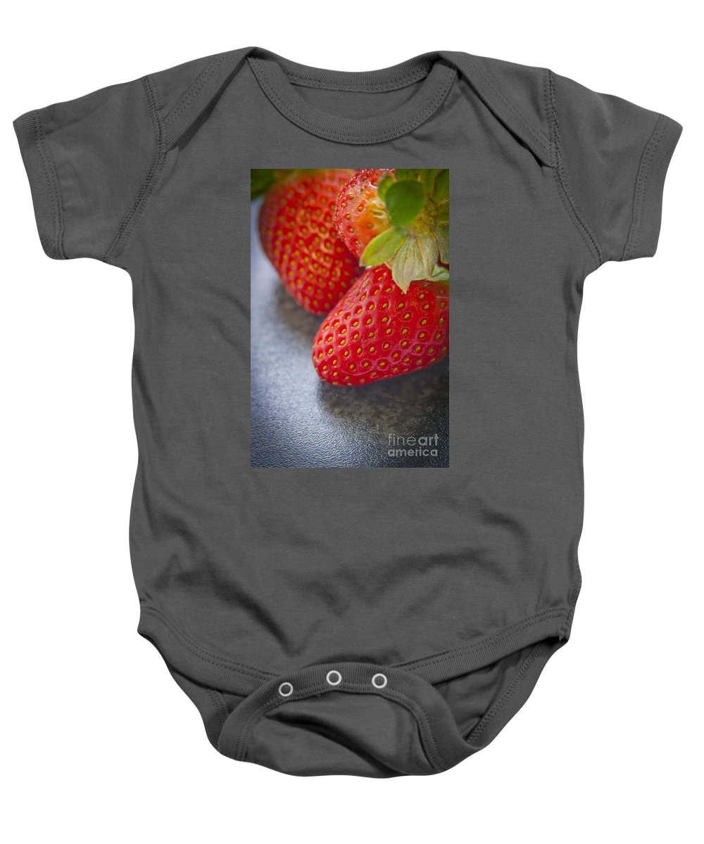 Macro Baby Onesie featuring the photograph Strawberries by Tim Hester