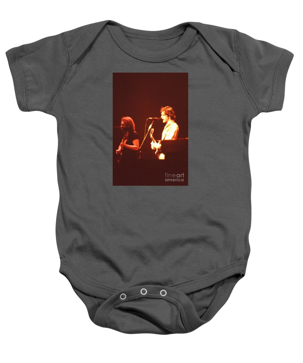 Music Baby Onesie featuring the photograph In Concert - The Grateful Dead by Susan Carella
