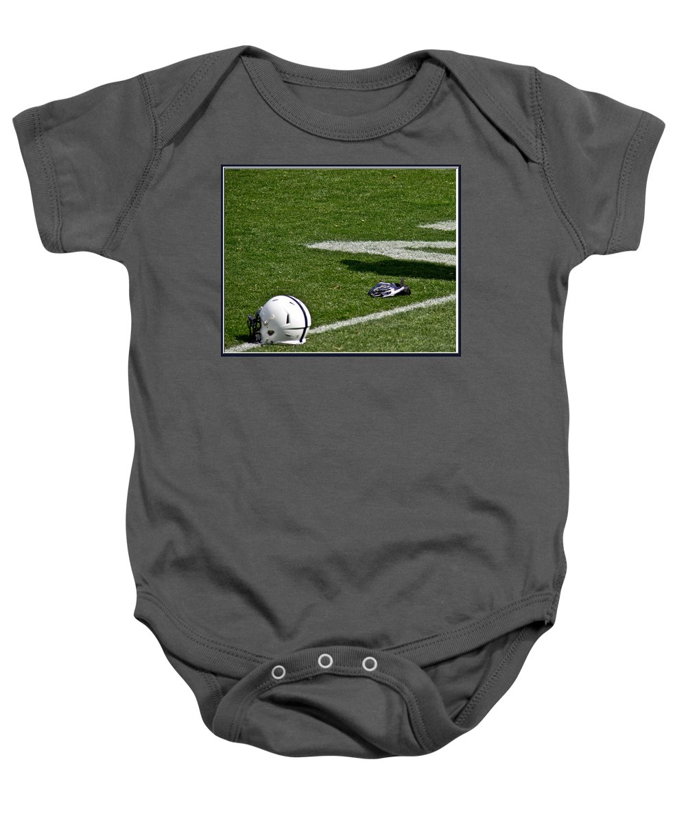 Football Baby Onesie featuring the photograph Tools Of The Game by Tom Gari Gallery-Three-Photography