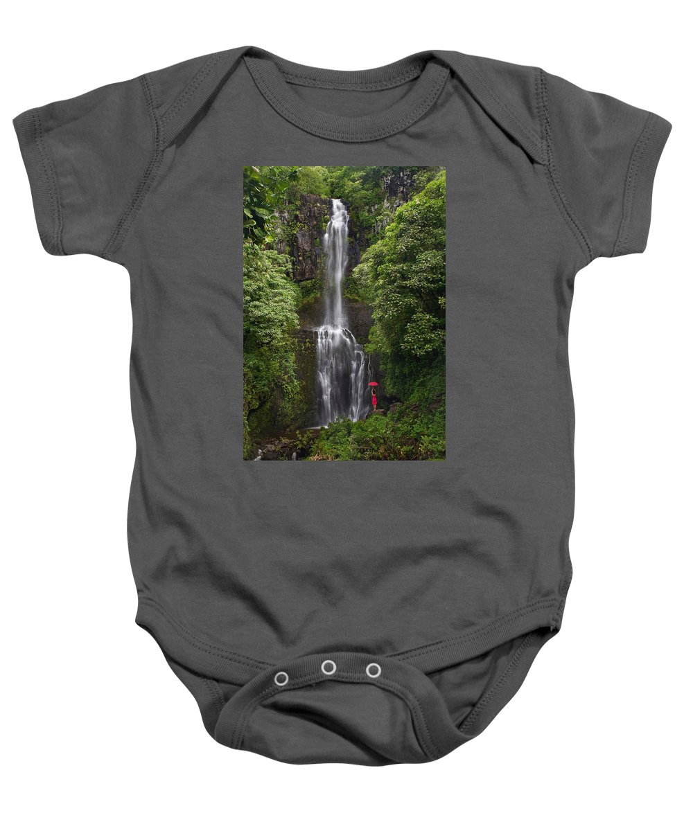 Beautiful Baby Onesie featuring the photograph Woman With Umbrella At Wailua Falls by M Swiet Productions
