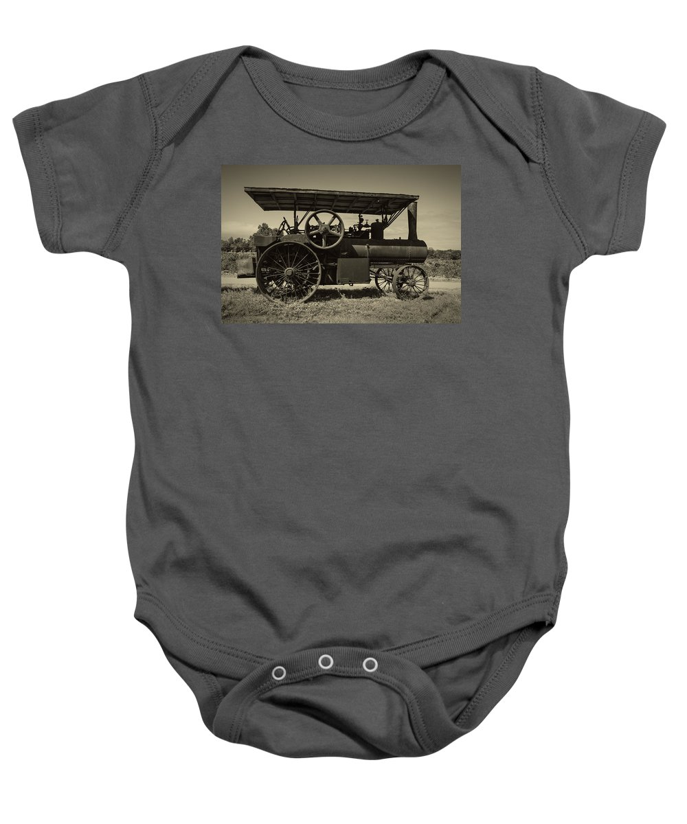 1921 Baby Onesie featuring the photograph 1921 Aultman Taylor Tractor by Debra and Dave Vanderlaan