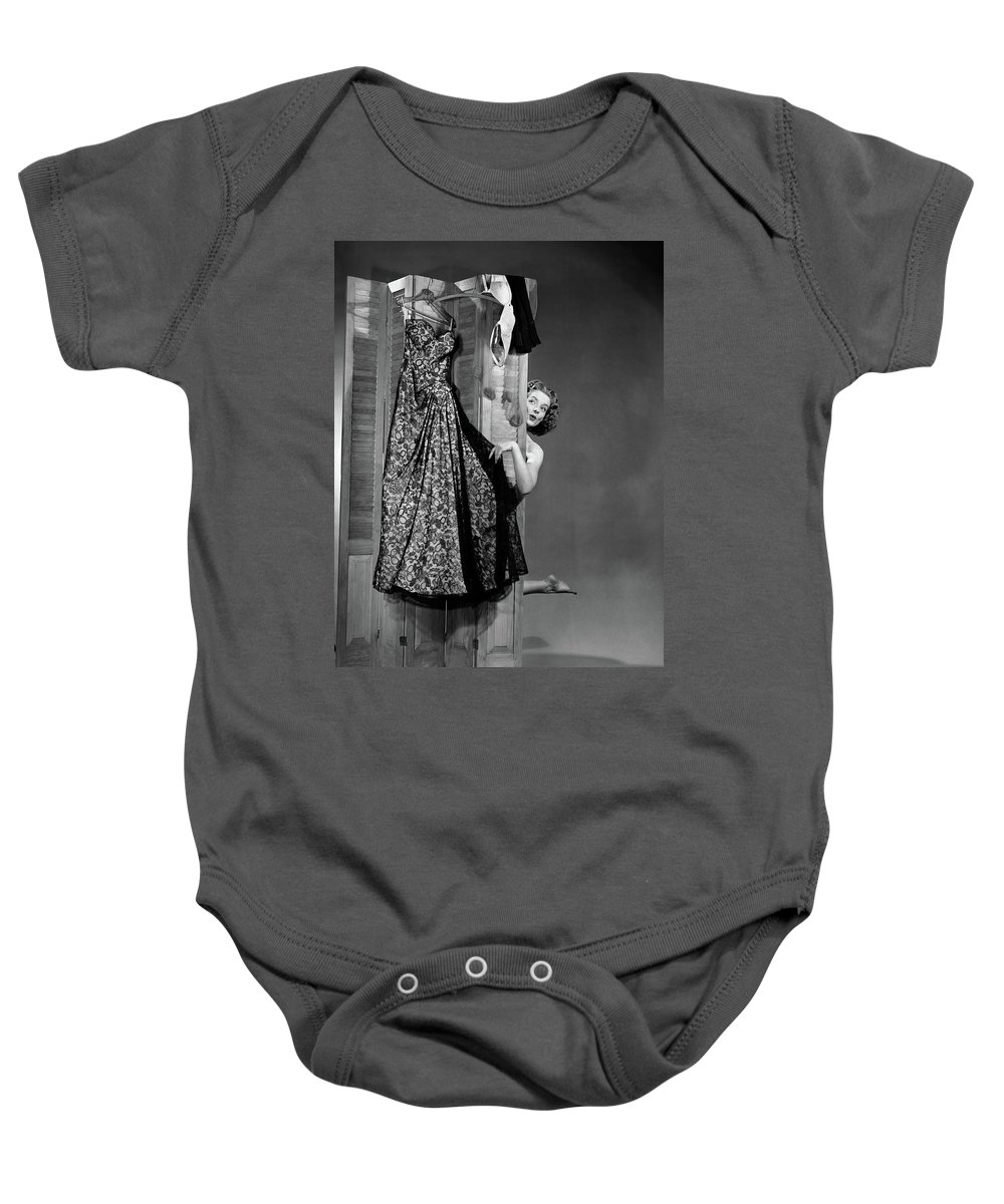 Photography Baby Onesie featuring the photograph 1950s Woman Peeking From Behind Screen by Vintage Images