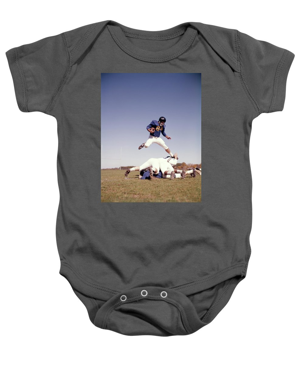 Photography Baby Onesie featuring the photograph 1960s Football Player Running Carrying by Vintage Images