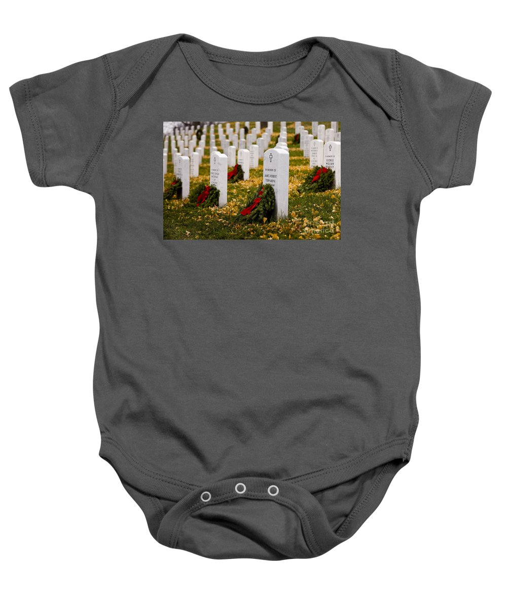 Arlington Baby Onesie featuring the photograph Christmas Wreaths Laid At The Arlington Cemetery by B Christopher