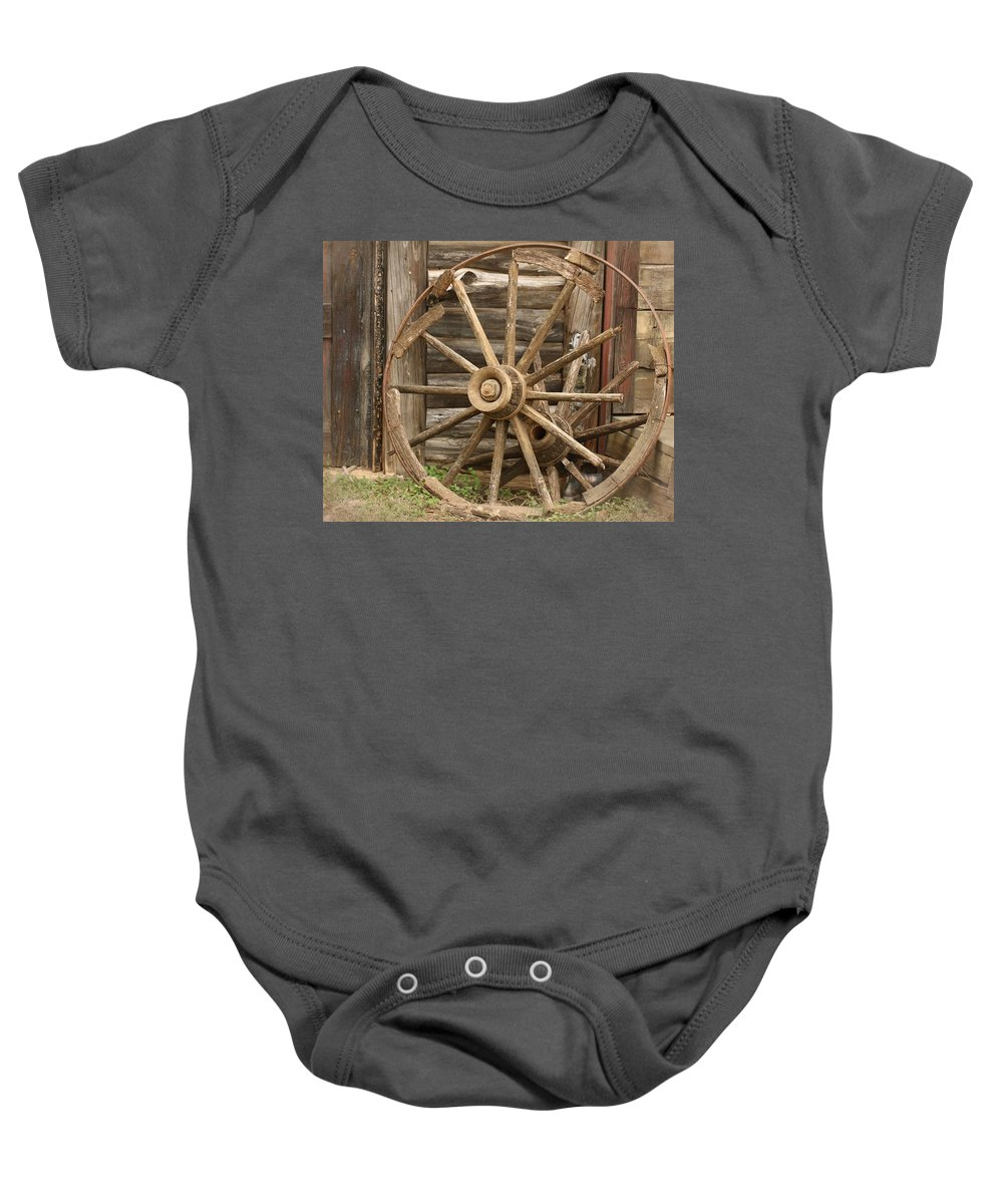 Wagon Wheel Baby Onesie featuring the photograph Wagon Wheel by Terry Fleckney