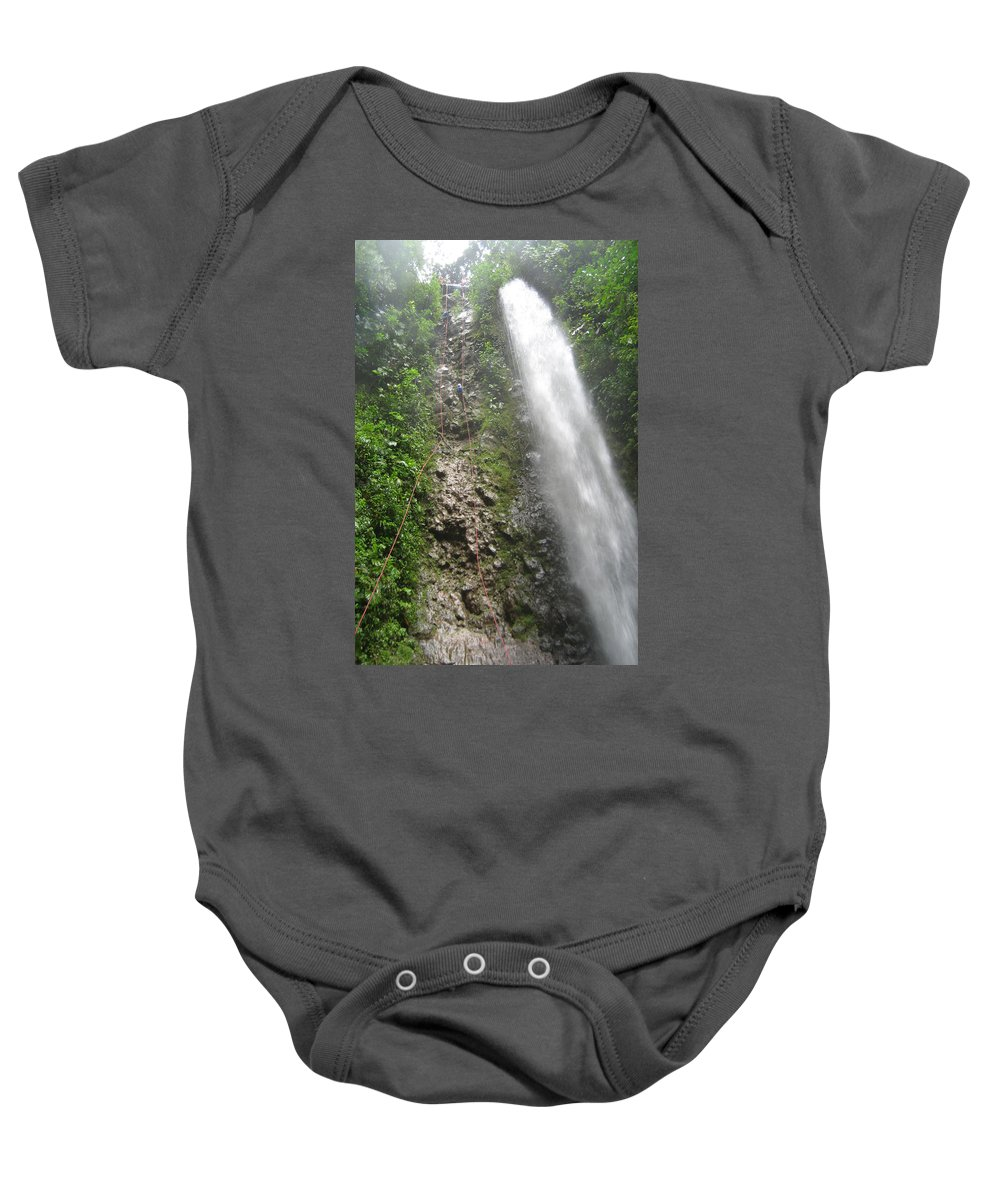 Rock Climbing Baby Onesie featuring the mixed media Rock Climbing Rope Climbing Costa Rica Vacations Waterfalls Rivers Recreation Challanges Facilitie by Navin Joshi