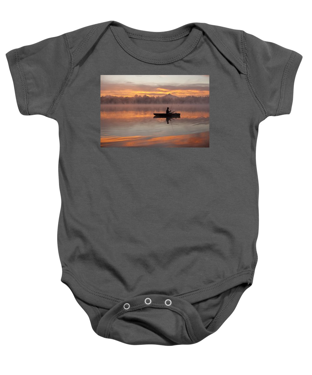 Landscape Baby Onesie featuring the photograph Sunrise In Fog Lake Cassidy With Fisherman In Small Fishing Boat by Jim Corwin