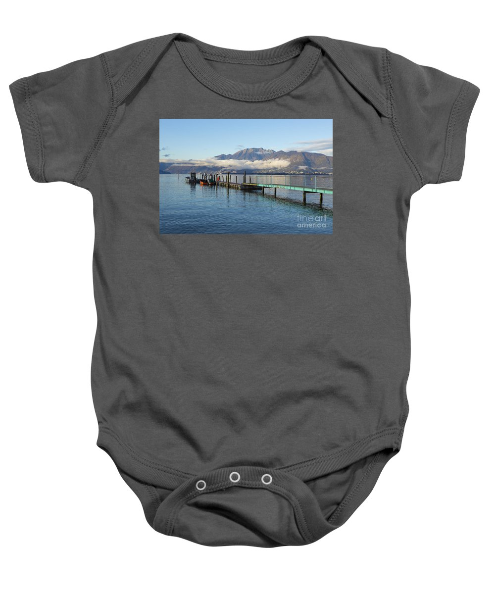 Lago Maggiore Baby Onesie featuring the photograph Alpine Lake by Mats Silvan