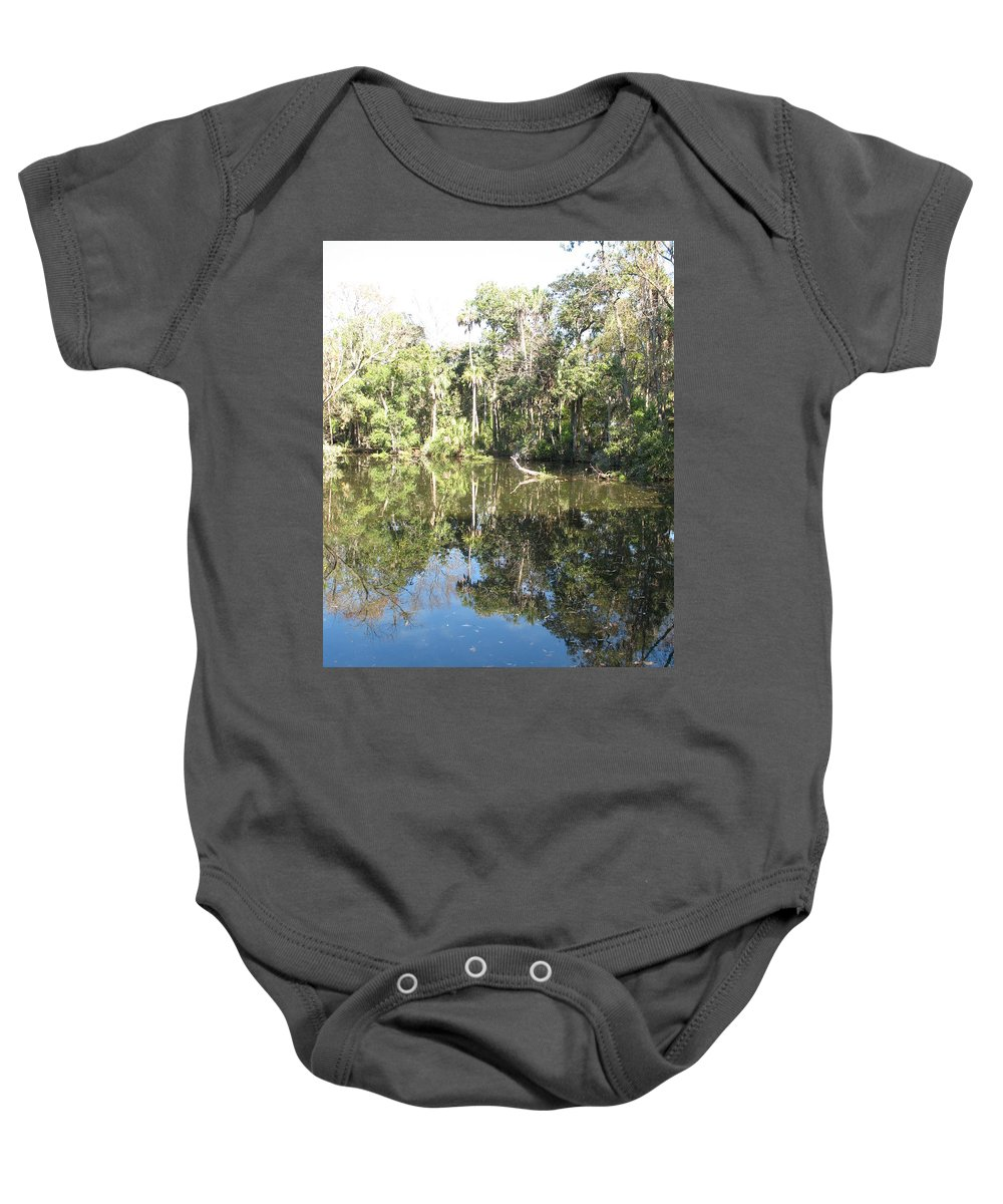 Swamp Baby Onesie featuring the photograph Swamp Reflection by Christiane Schulze Art And Photography