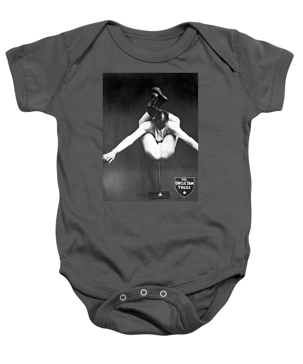 1920 Baby Onesie featuring the photograph A Contortionist On A Pedestal by Underwood Archives